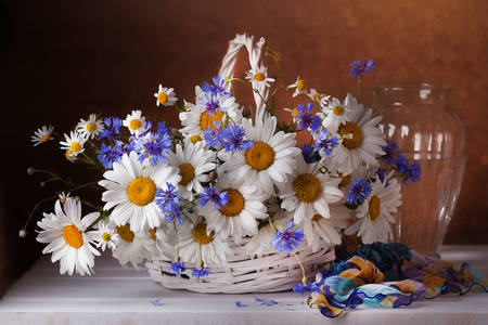 Chamomile and cornflowers in a basket