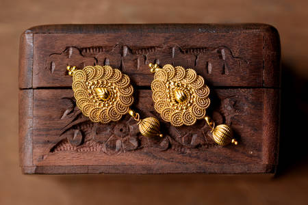 Gold earrings in oriental style