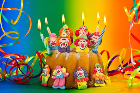 Cake with funny clowns and candles