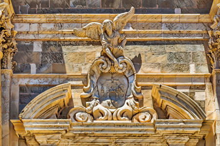 Angel statue on the facade of a church in Dubrovnik