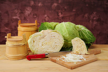 Fresh cabbage and barrels on the table