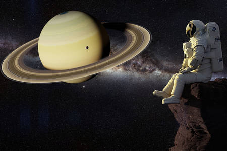 Astronaut and planet Saturn
