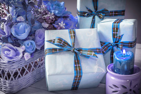 Gifts with blue ribbons and flowers