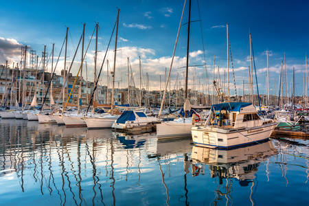 Yachts and sailboats at the pier in Birgu