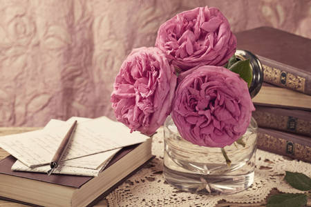 Books and roses on the table