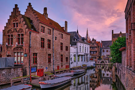 Bruges canal and houses at sunset