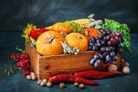 Vegetables and fruits in a wooden box