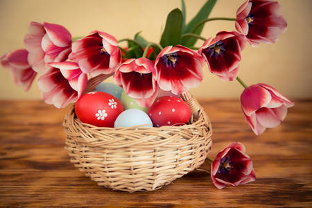 Easter eggs and tulips on the table