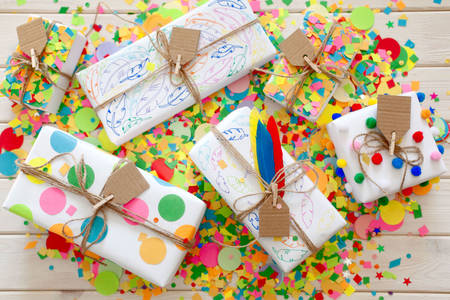 Gifts on colorful confetti