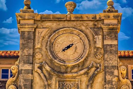 Antique clock on a building in Dubrovnik