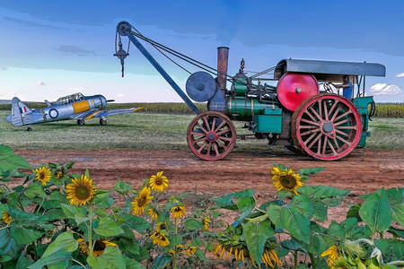 Steam tractor and airplane in the field