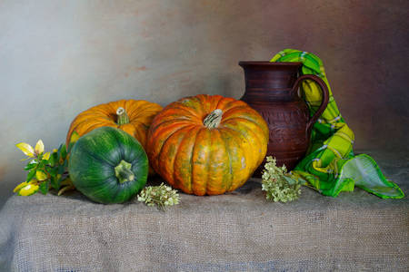Pumpkins and a jug on the table