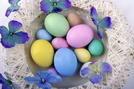 Easter eggs in a basket with flowers
