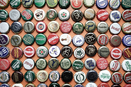 Beer caps of various brands of beer