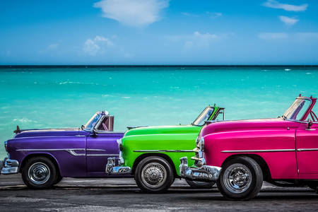 Colorful retro car by the sea