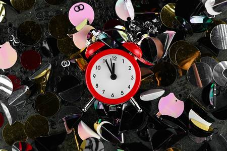 Alarm clock among sparkles