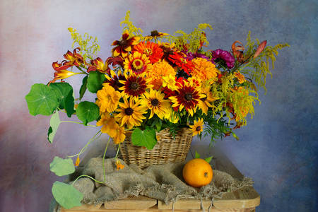 Flowers in a basket on the table