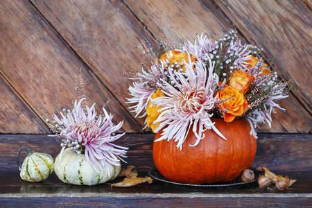 A bouquet of flowers in a pumpkin