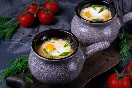 Soup with poached egg in a ceramic bowl