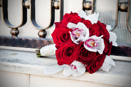 Wedding bouquet of roses and orchids